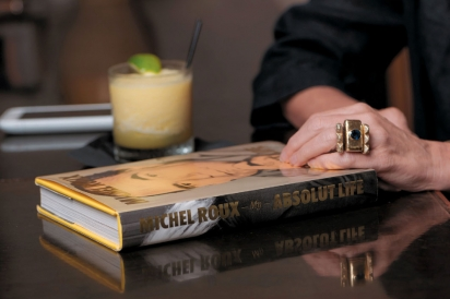 Book and cocktail on the table