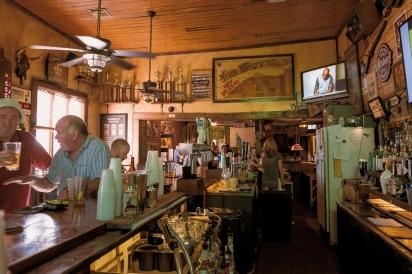 Patrons drink a sports bar