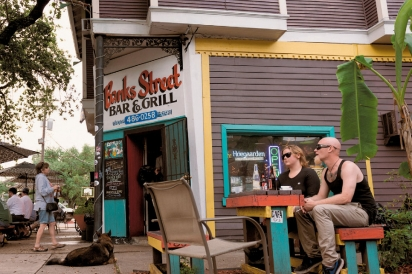 Patrons sit on outdoor seating for Banks Street, Bar & Grill