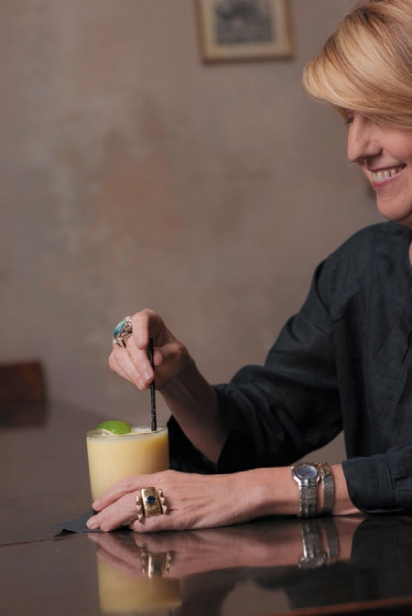 Ann Tuennerman holds a cocktail