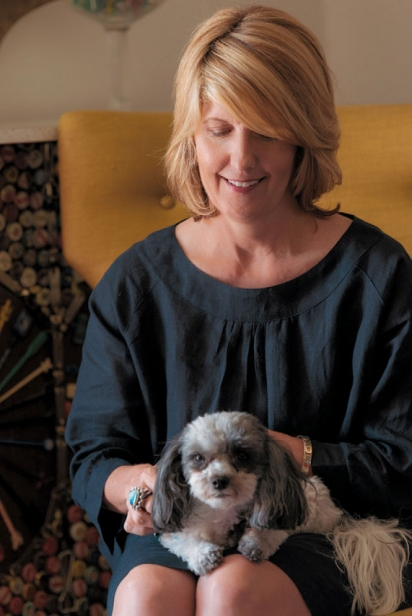 Ann Tuennerman with a puppy on her lap