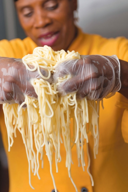 Ms. Green holding up spaghetti noodles