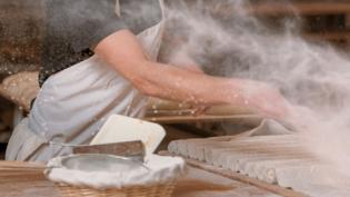 Putting flour on dough